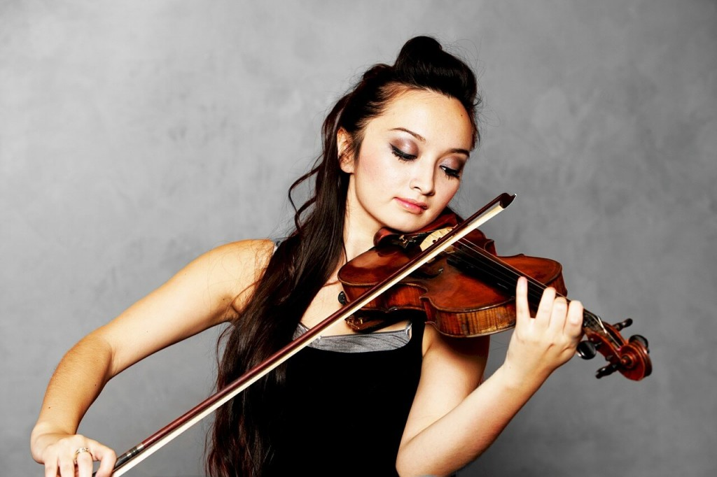 Playing violin. Practice with a Smile